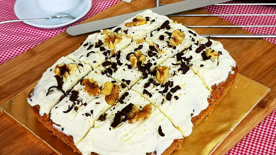 This easy carrot cake recipe is packed with the flavor of walnuts, chocolate chips, and of course, prepared with freshly grated carrots and brown sugar. This homemade carrot cake recipe is simple, straightforward, without cream in between layers, only with cream cheese topping and make use of my glass casserole dish for baking.